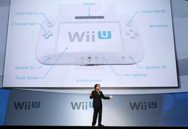110457-satoru-iwata-president-of-nintendo-co-ltd-presents-the-new-wii-u-contr